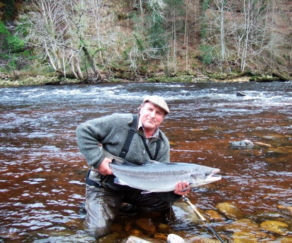 Releasing a superb salmon back into the river