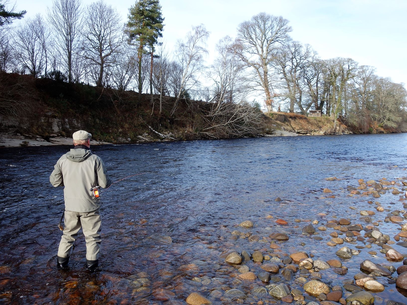 Opening day and David Tisdale casts a line over Roan Pool on Altyre Estate, River Findhorn