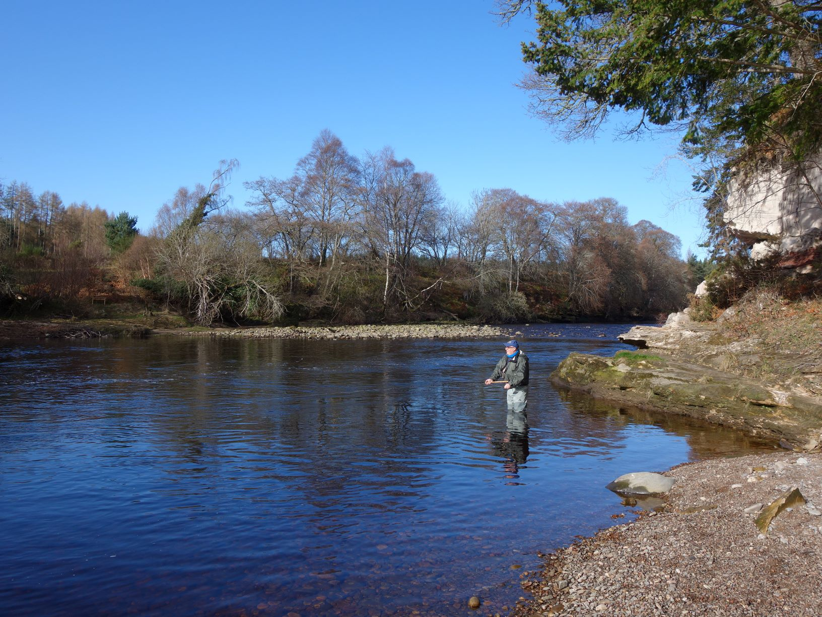 Des Dunlop casts a fly over the Scur Pool on Meads of St. John Beat, Darnaway, River Findhorn