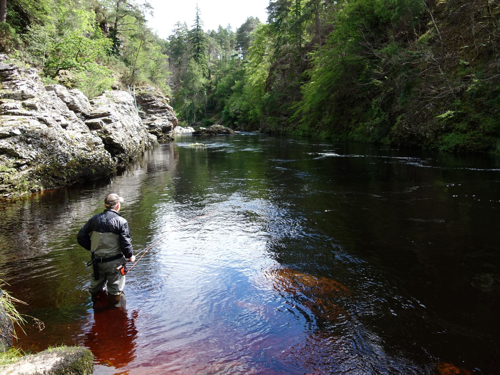 Leslie Tyson casts a fly over Craigie Pool, Upper Home, Darnaway, River Findhorn