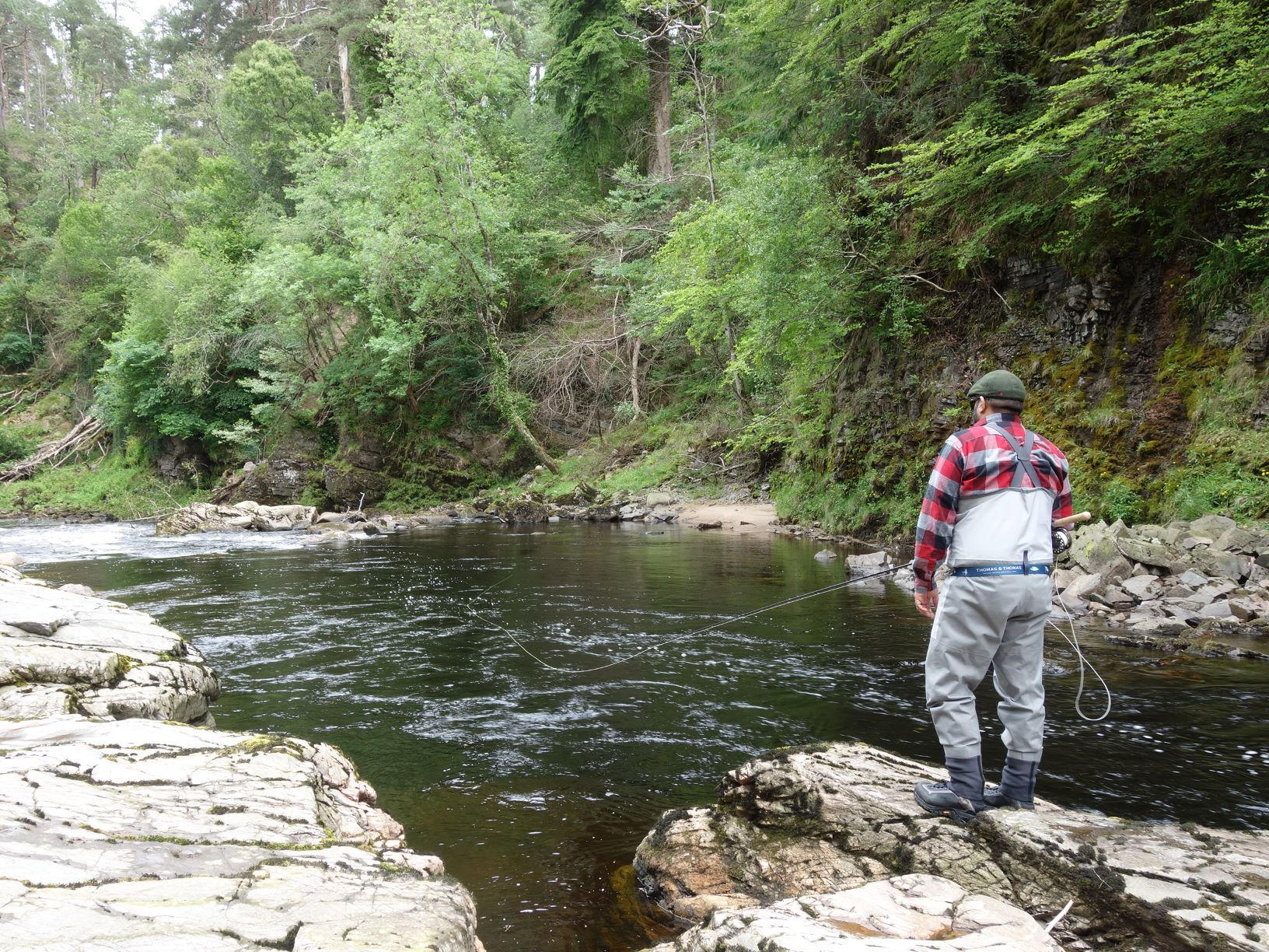 Mark Zuzarte from USA casts a line over the Lower Flags Pool on Upper Home Beat, Darnaway, River Findhorn