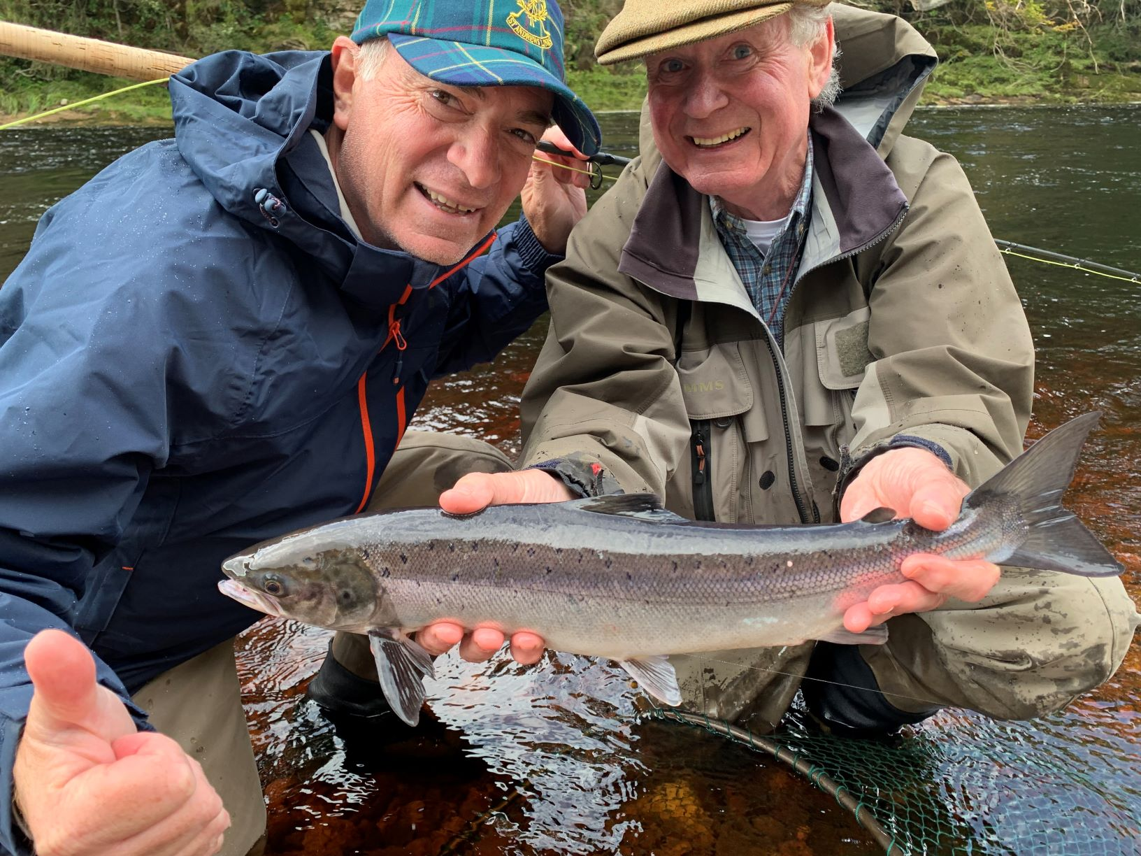 Pete Love with his first ever Atlantic salmon (grilse) from Palamore Pool on Altyre Estate, River Findhorn