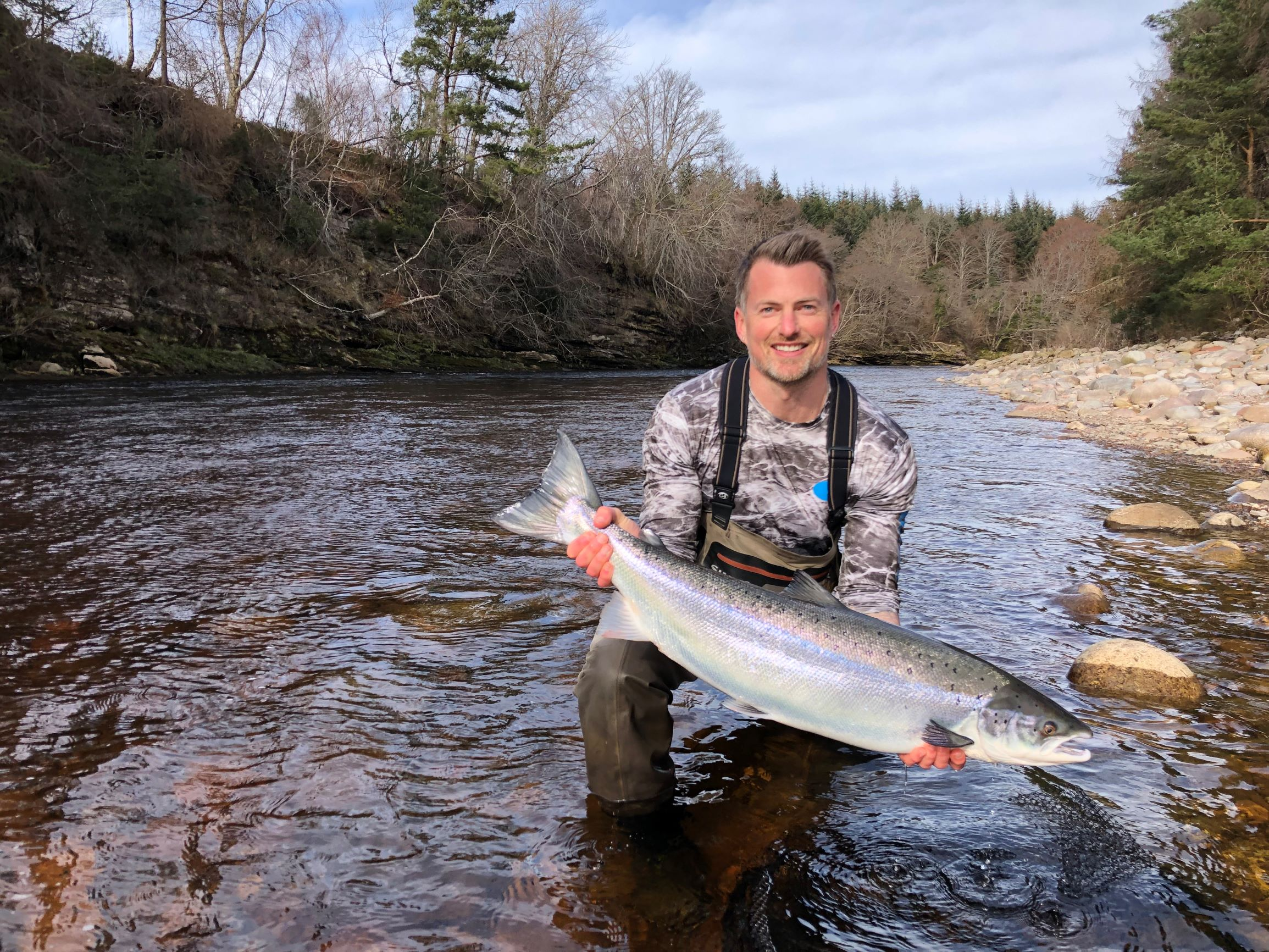 James Stokoe lifts up his first ever Scottish salmon of around 18 lbs. from Palamore Pool, Altyre Estate, River Findhorn.